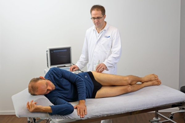 Ultrasound investigation of a patient in the hip centre of the Orthopaedic Gelenk-Klinik